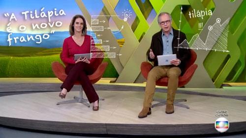 Repórteres da Globo apresentando matéria sobre a criação de tilápias
